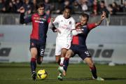 Dessena, left, in action for Cagliari against AC Milan last season. Picture: Action Images