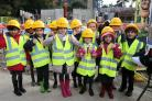 Pupils put on high visibility jackets and hard hats on their trip