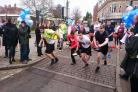 Runners start the pancake race in Rickmansworth
