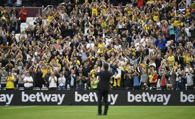 Mutual appreciation: Walter Mazzari and the Hornets fans at full time. Picture: Action Images