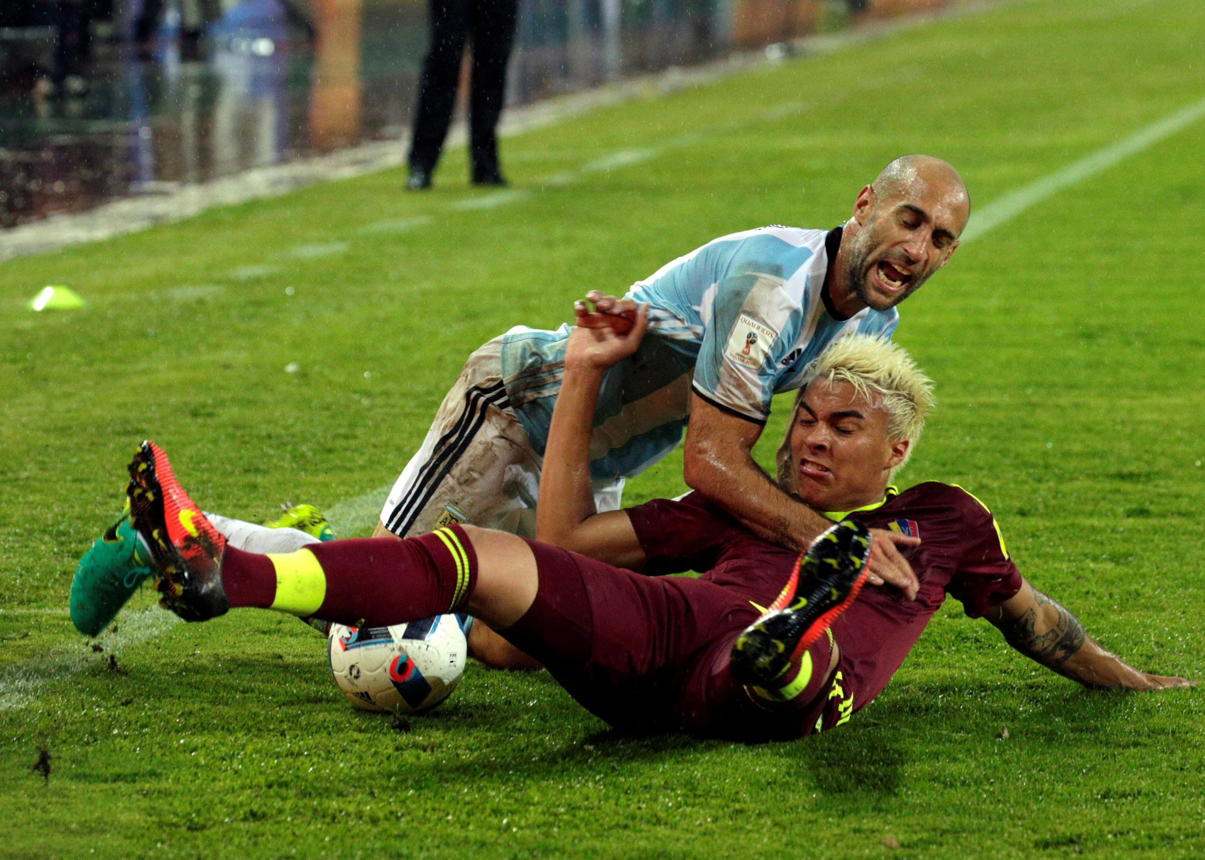 Adalberto Penaranda tangles with Pablo Zabaleta during Venezuela's World Cup qualifier against Argentina in September. Picture: Action Images