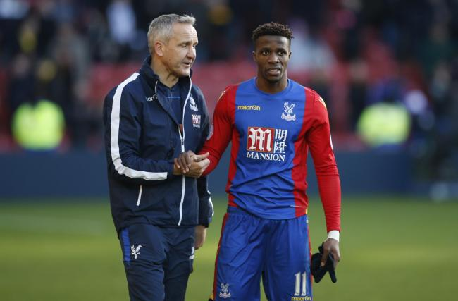Wilfried Zaha and Palace assistant boss Keith Millen following Harry the Hornet's antics yesterday. Picture: Action Images