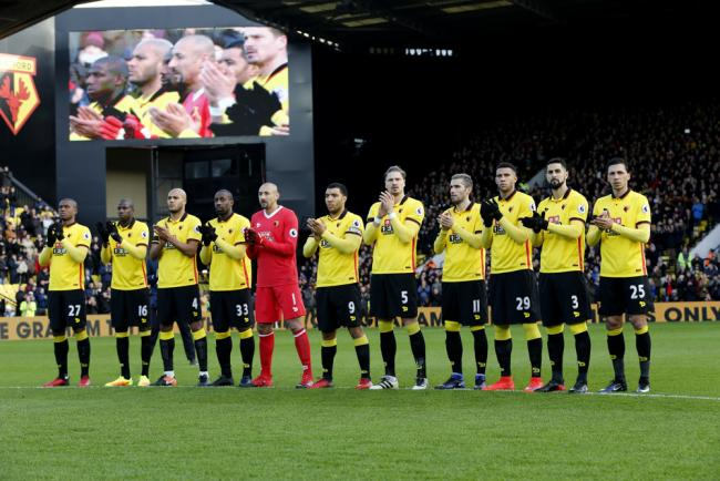 Watford and Middlesbrough observe a minute's applause prior to kick-off. Picture: Holly  Cant