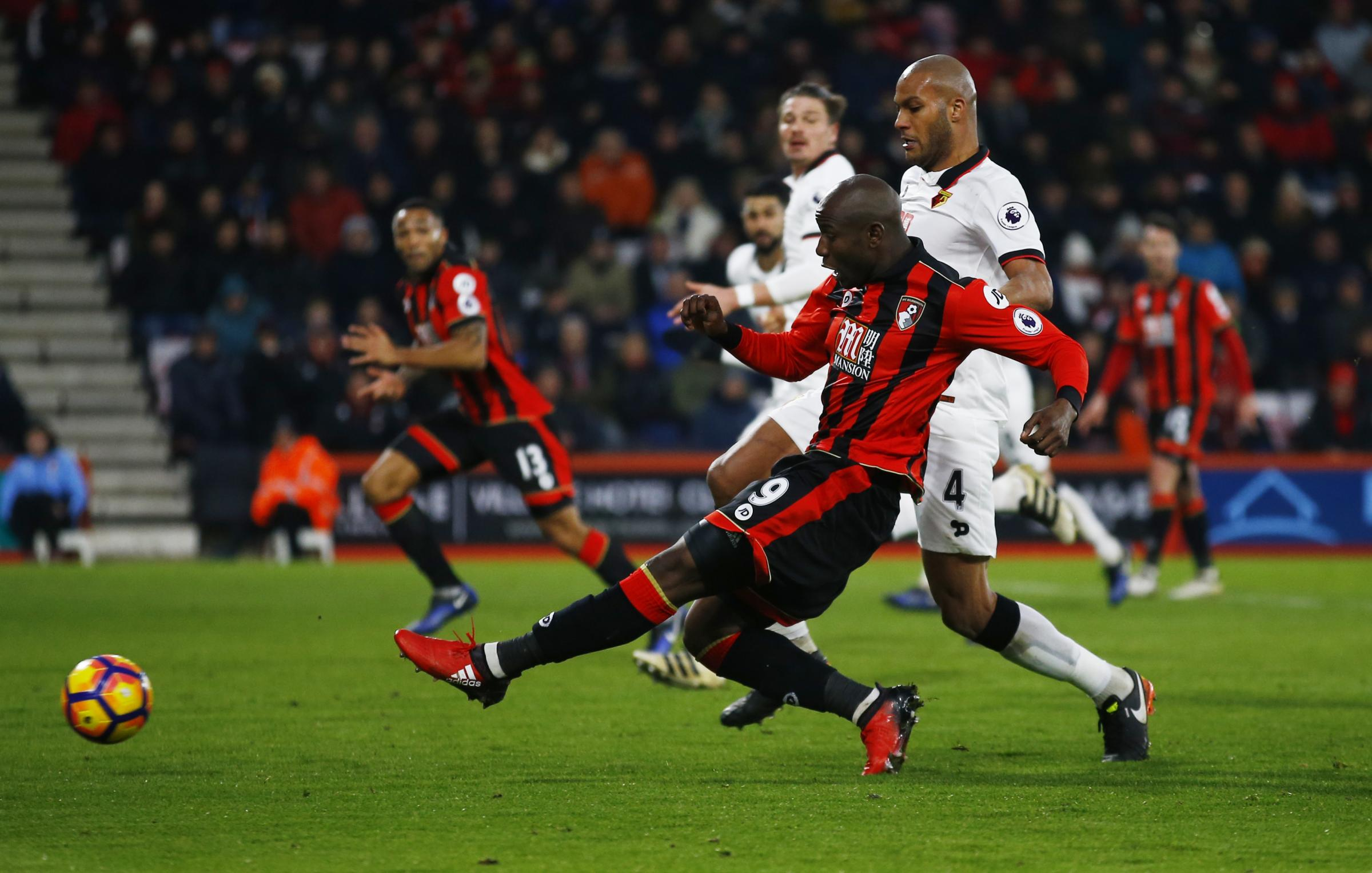 Benik Afobe gets away from Younes Kaboul to fire Bournemouth level for a second time. Picture: Action Images