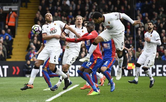 Troy Deeney heads into his own net to hand Crystal Palace all three points. Picture: Action Images