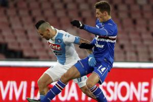 Patrik Shick (right) attempting to win the ball from Marek Hamsik. Picture: Action Images