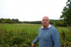 Cllr Stephen Giles-Medhurt at the proposed site in Fairways Farm