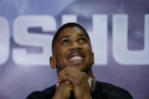 A relaxed Anthony Joshua during yesterday's pre-fight press conference. Picture: Action Images