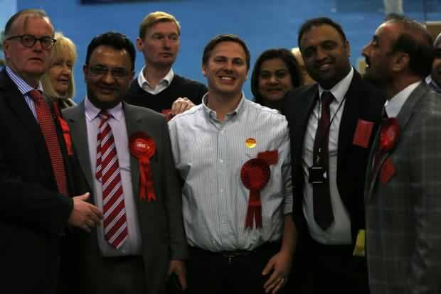 Labour councillors at today's count at Watford Leisure Centre