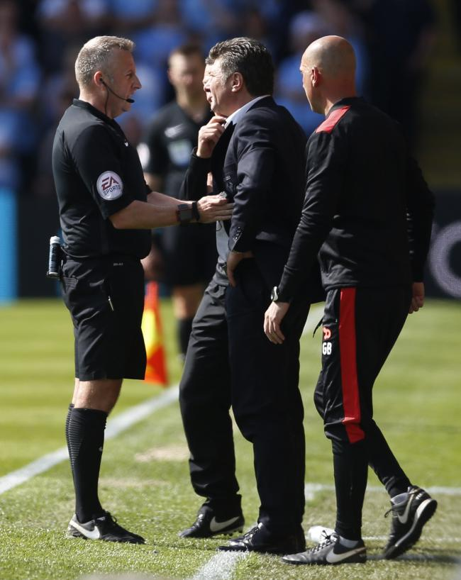 Walter Mazzarri remonstrating with referee Jon Moss during the 5-0 defeat to Manchester City. Picture: Action Images