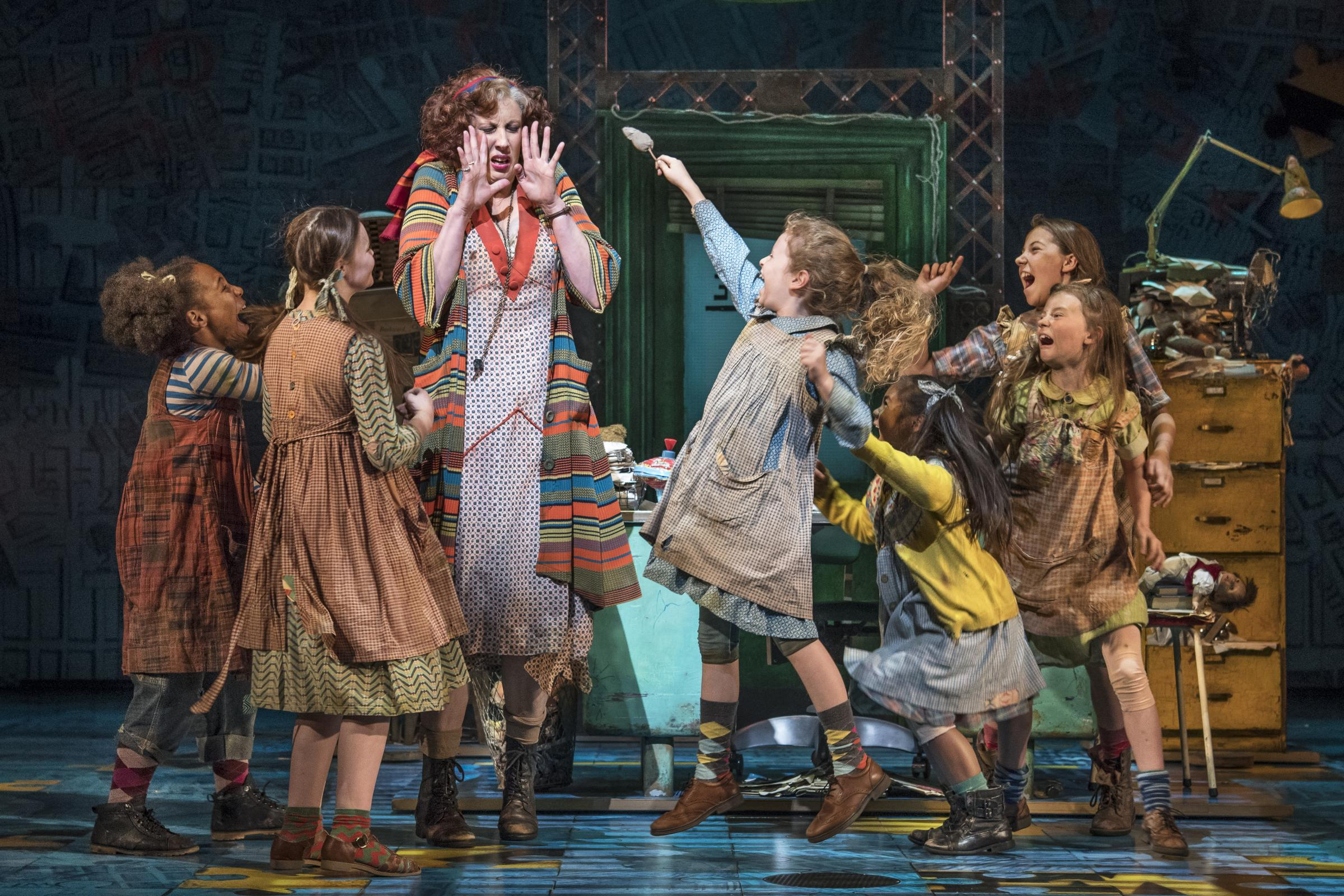 Miranda Hart's Miss Hannigan is plagued by the orphans (Photo: Paul Coltas)