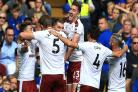 Sam Vokes celebrates his second and Burnley's third goal at Stamford Bridge