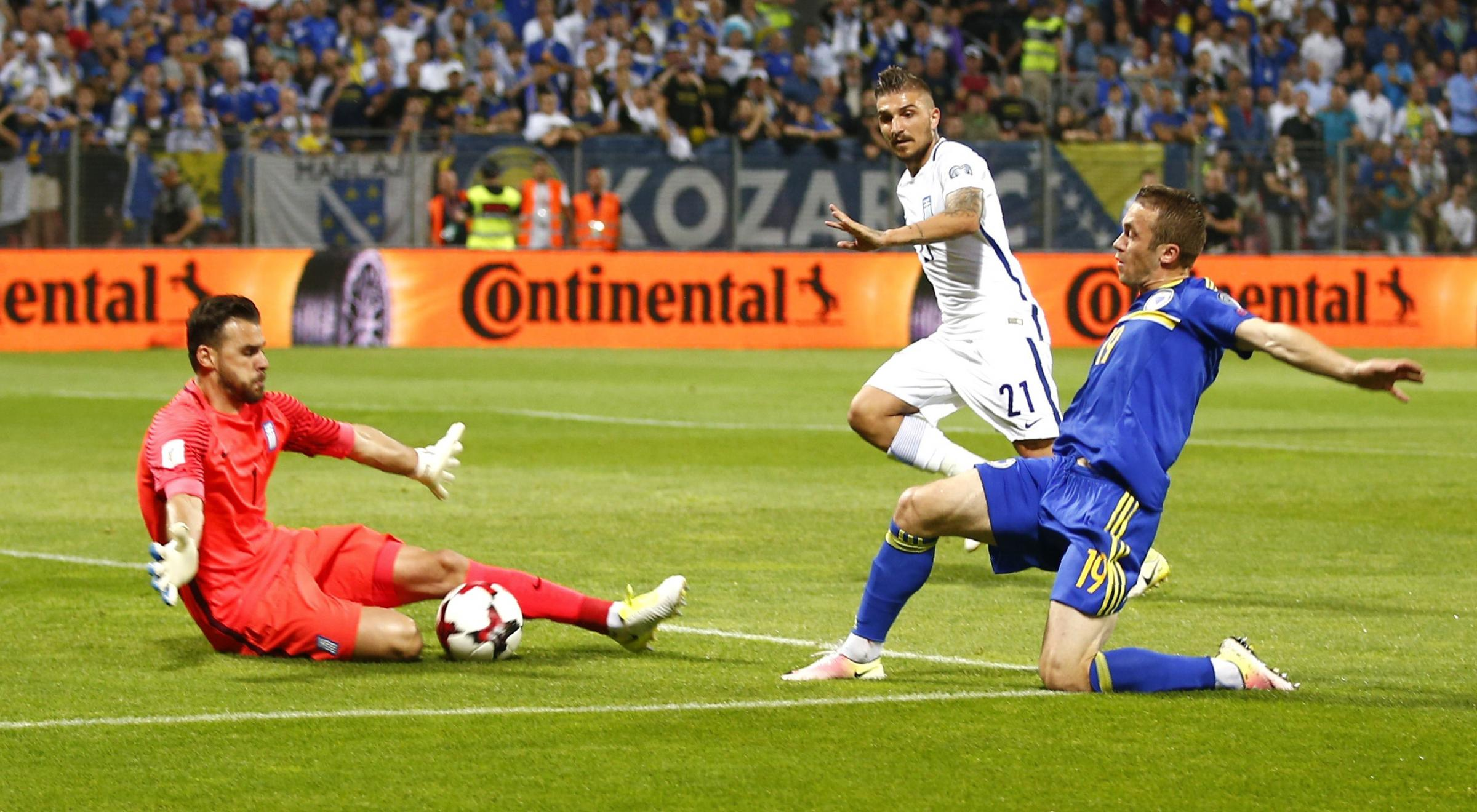 Orestis Karnezis (left) could do little as Greece fell to a 2-1 defeat to Belgium last night. Picture: Action Images
