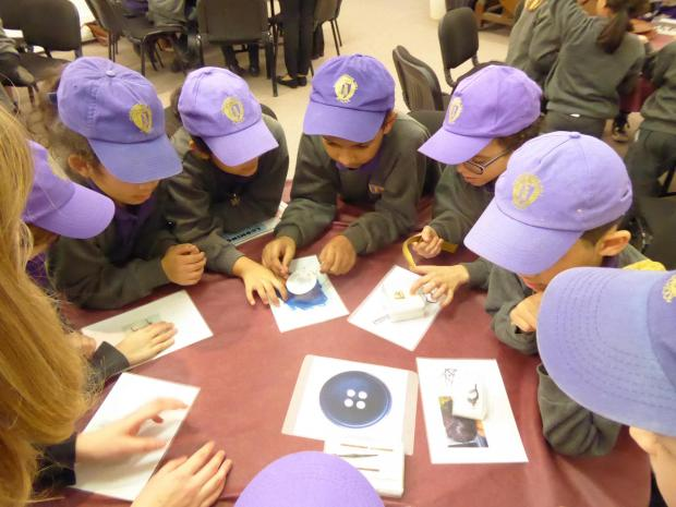 Watford Observer: Children from Cunningham Junior School handling artefacts at Verulamium Museum