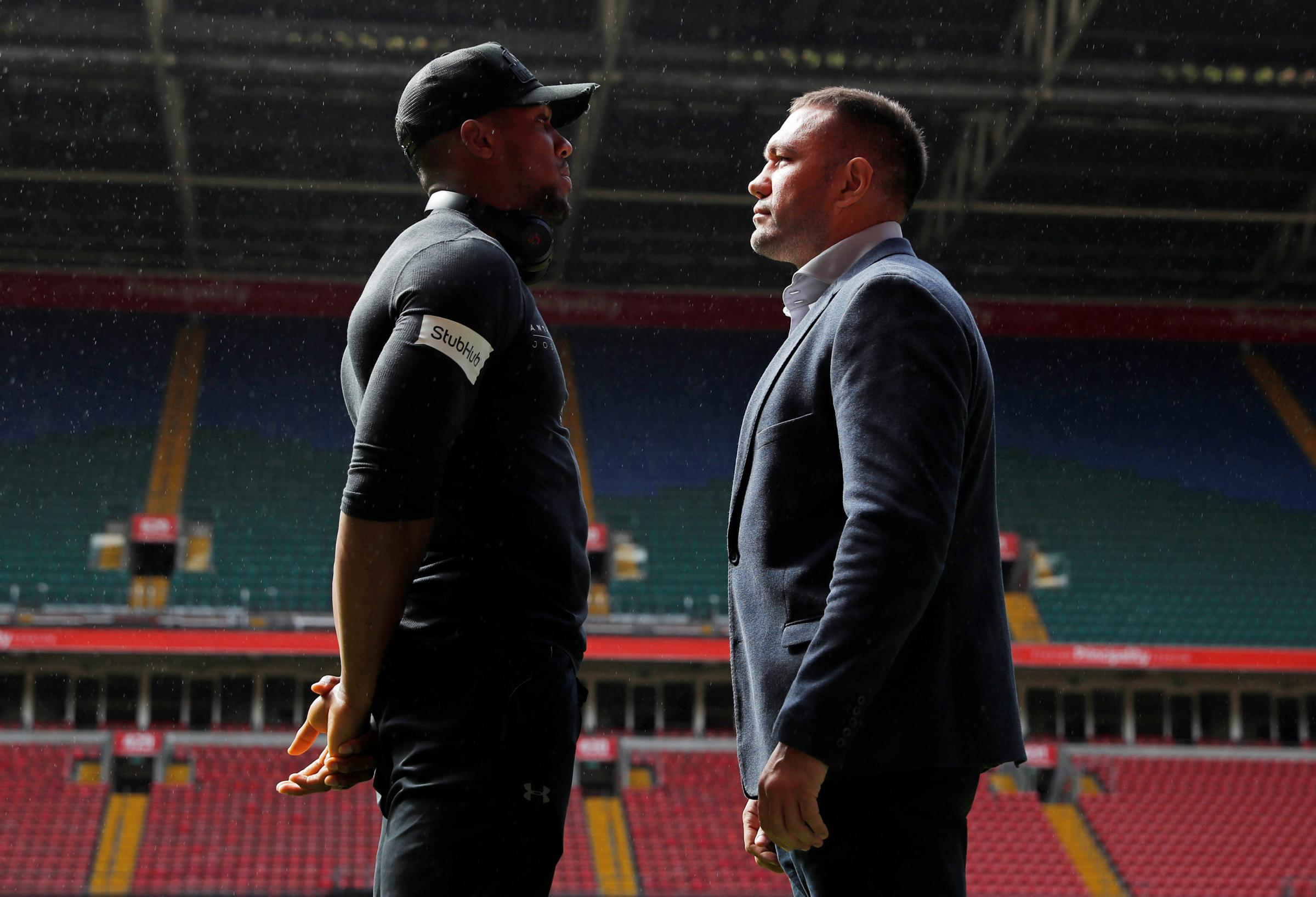 Facing off: Anthony Joshua and Kubrat Pulev in the Principality Stadium. Picture: Action Images
