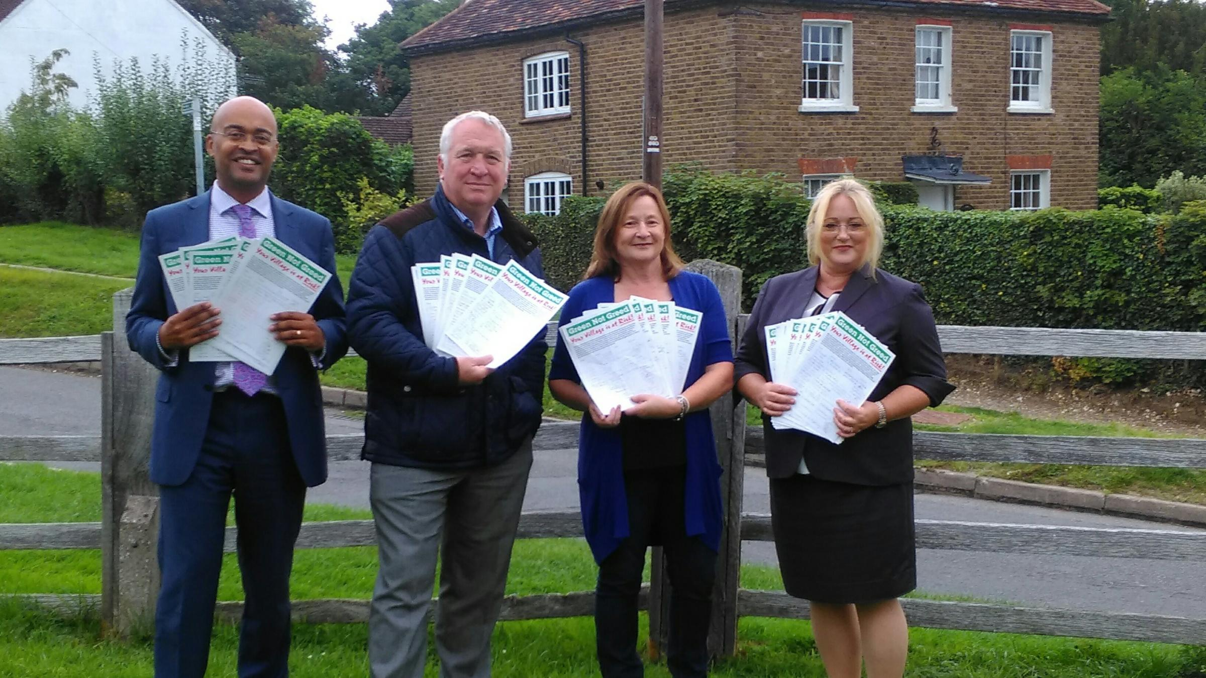 Campaigners hand over their petition sheets to Hemel Hempstead MP Mike Penning (second left)