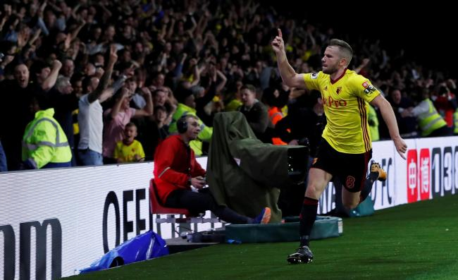 Ecstacy: Tom Cleverley celebrates with the jubilant Hornets fans. Picture: Action Images