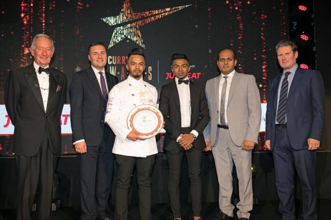 Mohammed Mihad Rahman (wearing white) shows off his coveted award