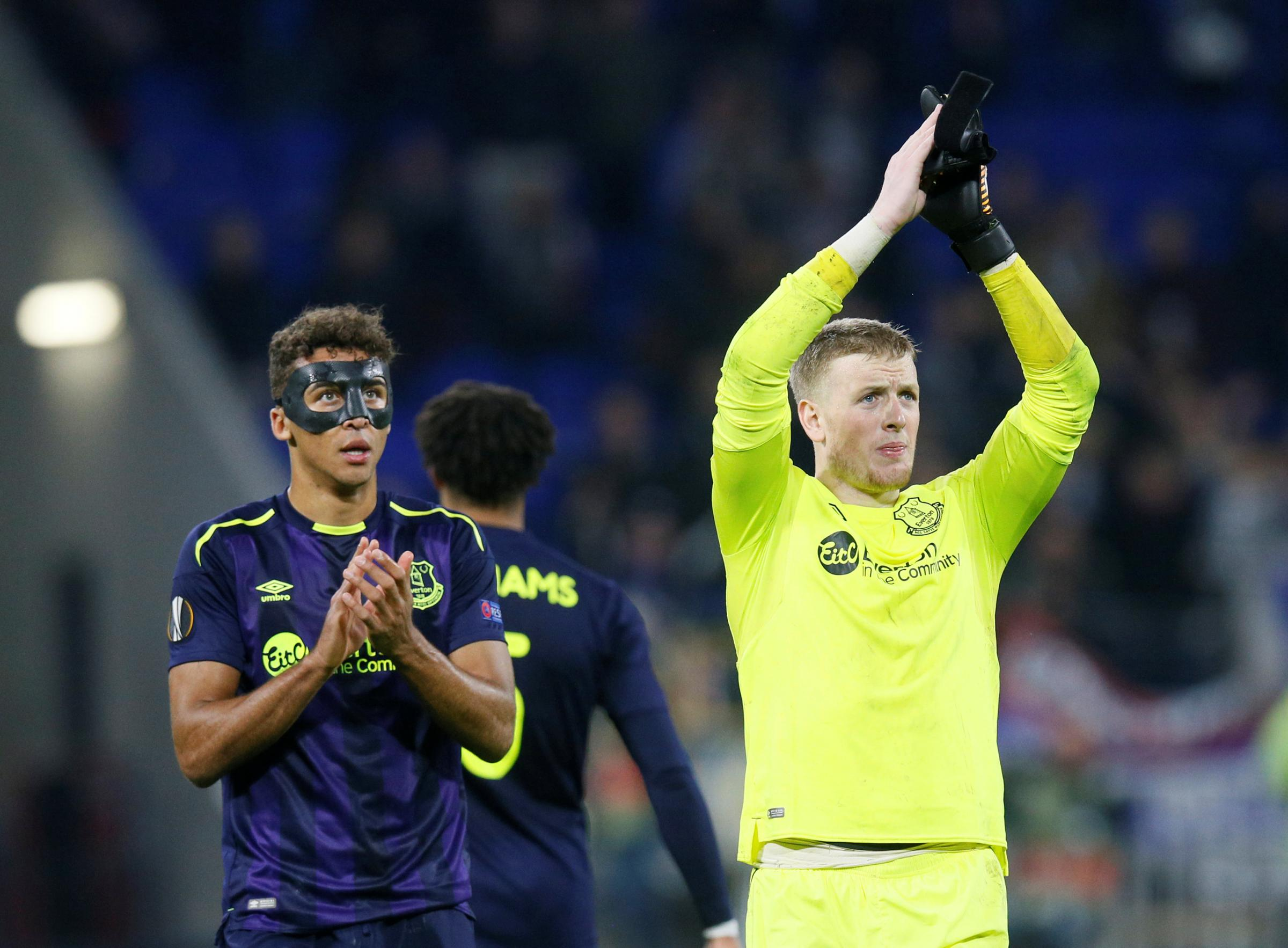 Dominic Calvert-Lewin and Jordan Pickford applaud the Everton fans following yesterday's Europa League exit. Picture: Action Images