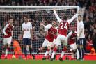Shkodran Mustafi celebrates scoring the opener