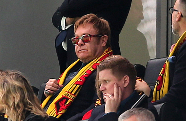 Elton John, watching his beloved Watford FC
