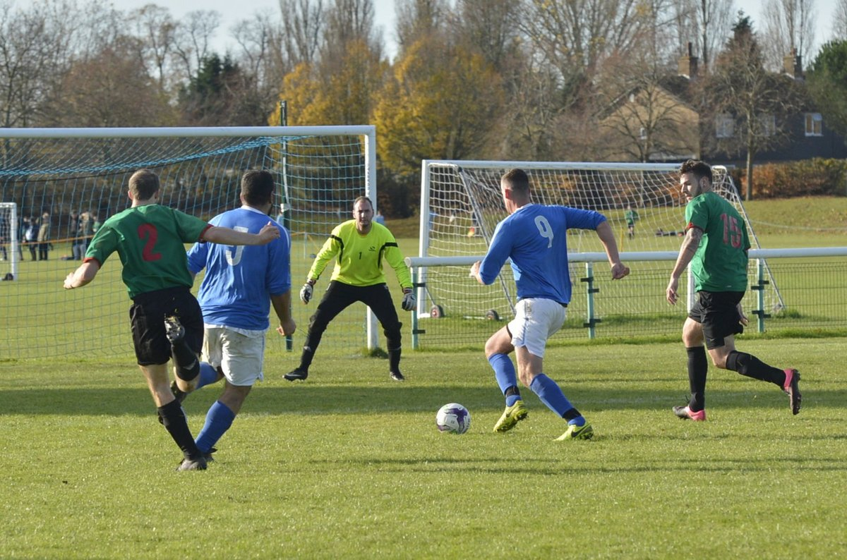 Bushey Sports Club (blue shirts) beat North Watford to open up a four-point lead at the top of Division One. Picture: Len Kerswilll