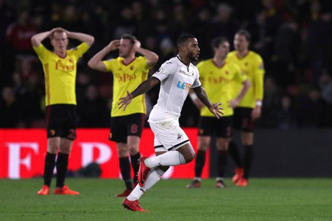 The Hornets are left holding their heads as Luciano Narsingh celebrates scoring Swansea's winner. Picture: Action Images