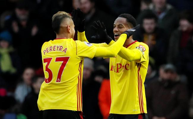Andre Carrillo and Roberto Pereyra, two of Watford's stand-out players, celebrate the former's goal. Picture: Action Images
