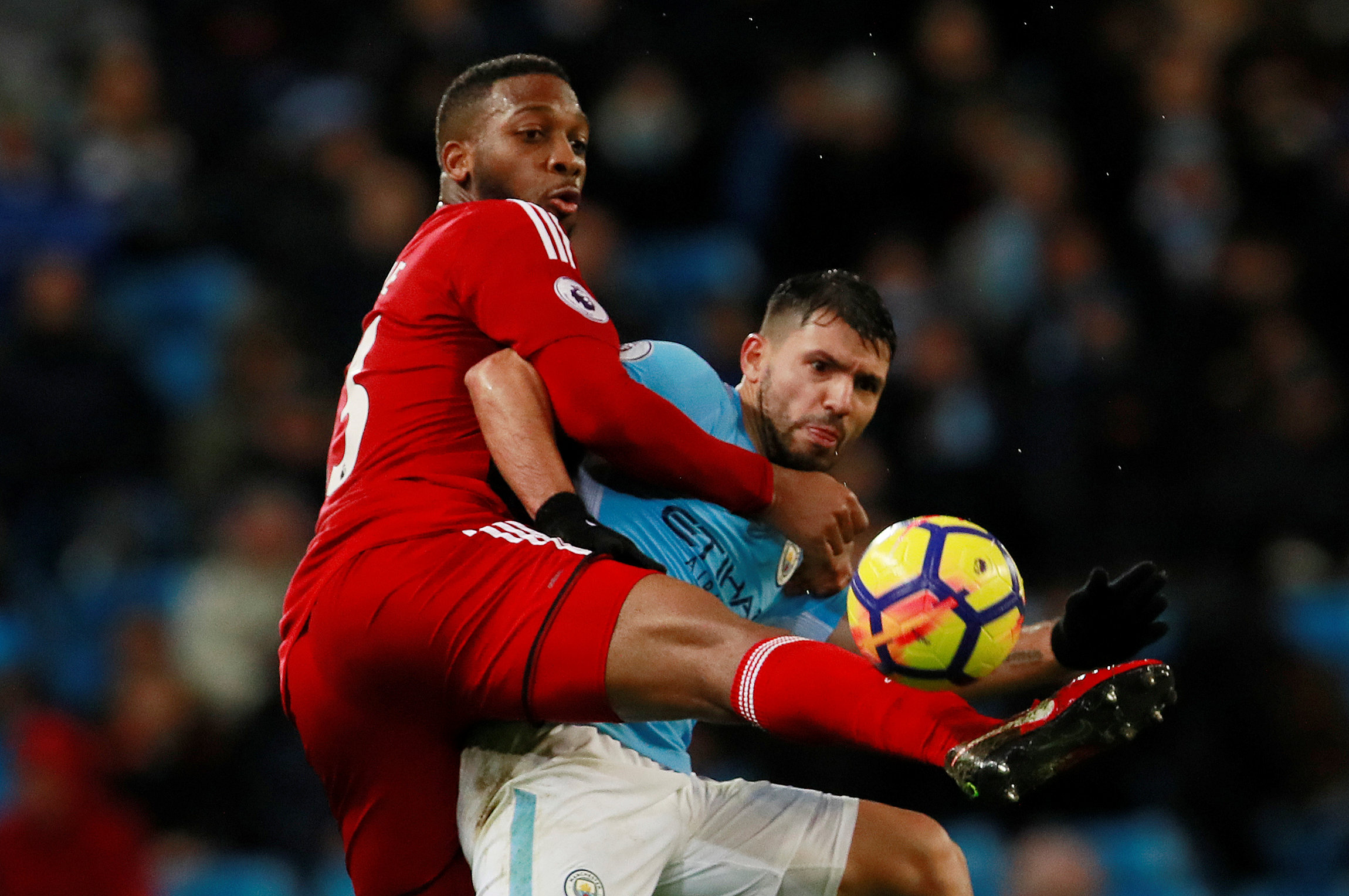 Molla Wague challenges Sergio Aguero during the Hornets' defeat at Manchester City. Picture: Action Images