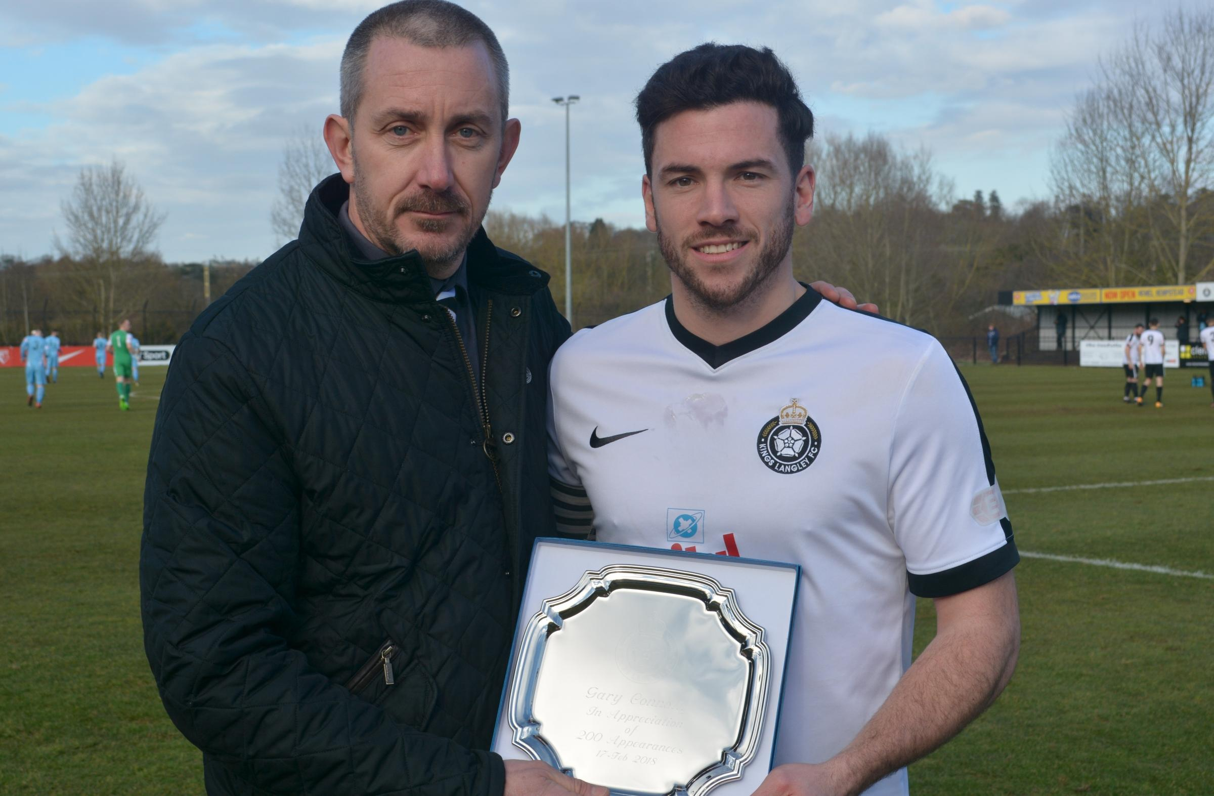 Gary Connolly receives a commemorative salver from Kings chairman Jeremy Wilkins. Picture: Chris Riddell