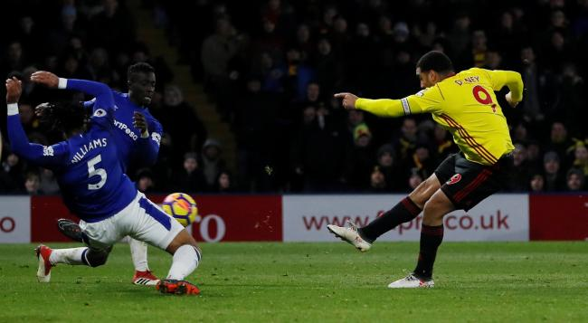 Troy Deeney fires home the all-important goal. Picture: Action Images