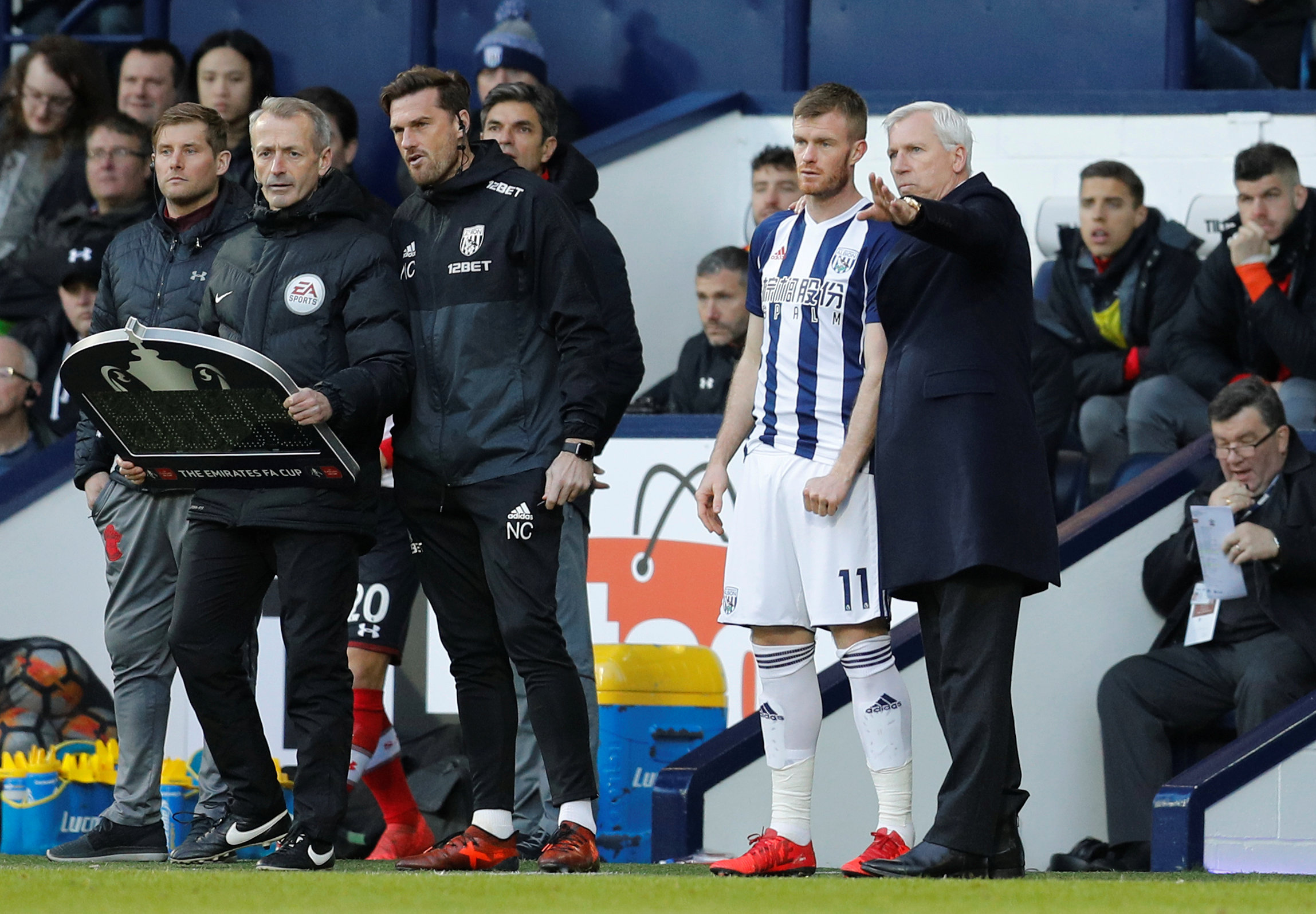 Exchanging views: Alan Pardew and Chris Brunt. Picture: Action Images