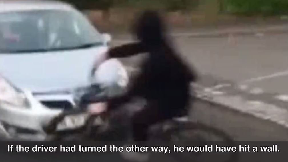 Watch cyclist purposely swerve into car as police release video in bid to tackle 'stupid game'