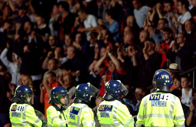Riot police had to be deployed at Vicarage Road in 2001 to deal with trouble caused by Luton Town fans. Picture: Action Images