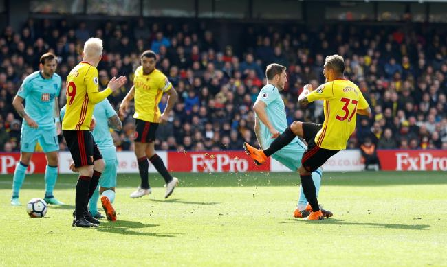 Will Hughes looks on as Roberto Pereyra fires Watford in front. Picture: Action Images