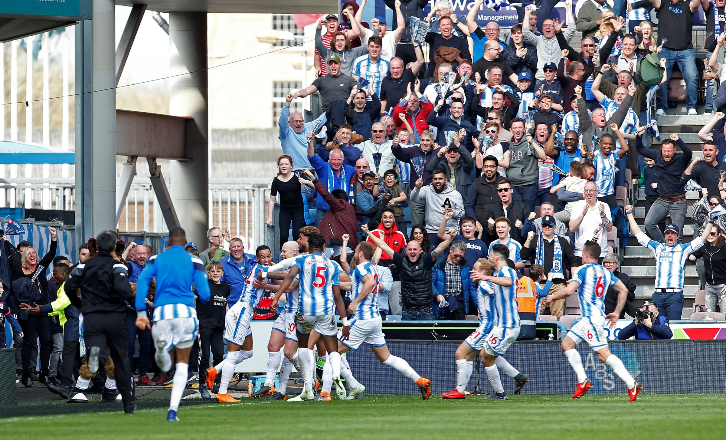Huddersfield celebrate their last-gasp success. Picture: Action Images