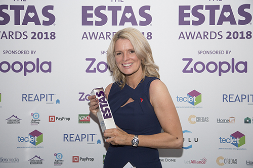 Alison Nunez, Managing Director at Andrews Property Group with one of the firm's ESTAs Awards