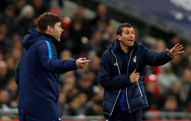 Javi Gracia and Mauricio Pochettino try to get their points across. Picture: Action Images