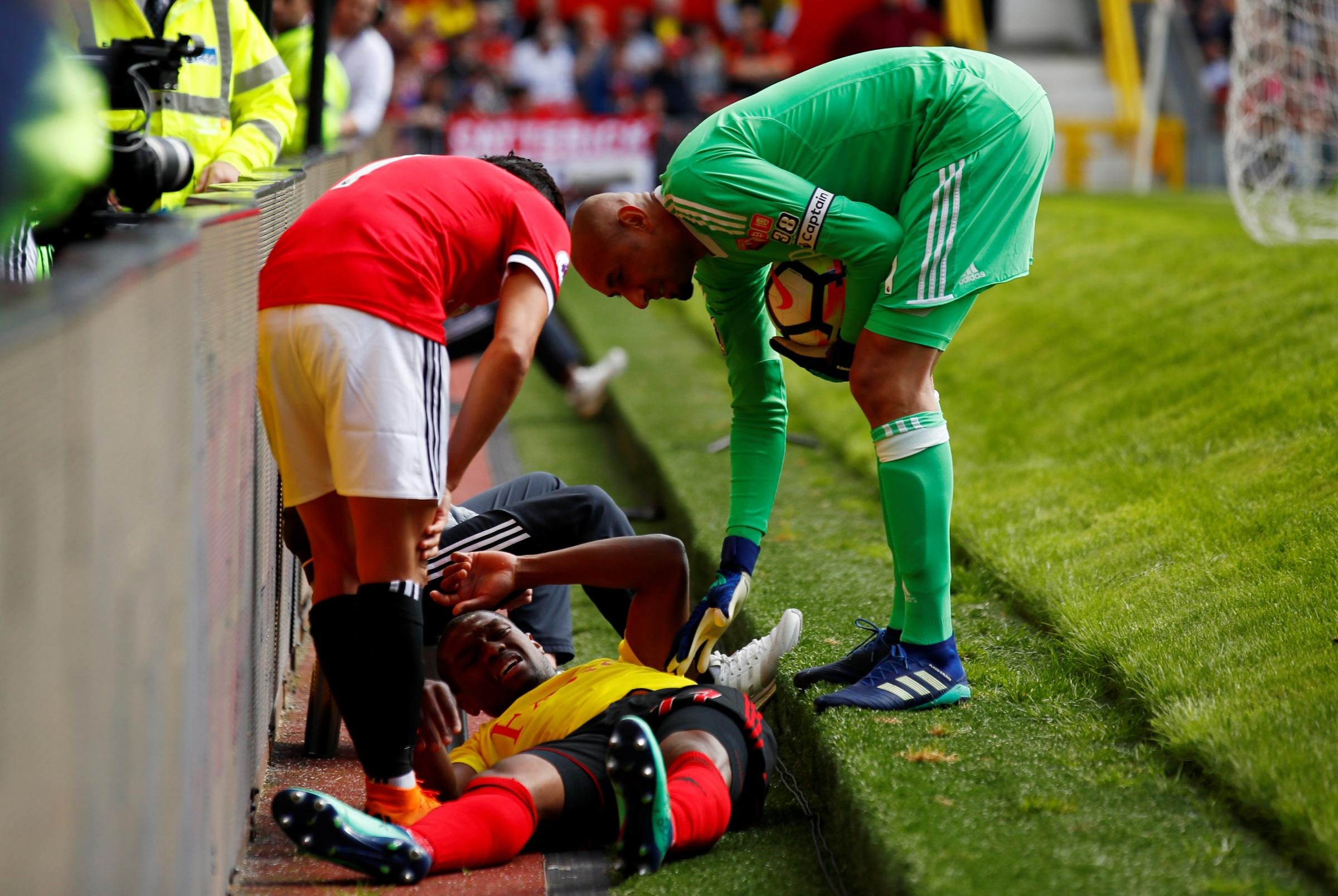 Christian Kabasele was injured after colliding with an advertising board. Picture: Action Images