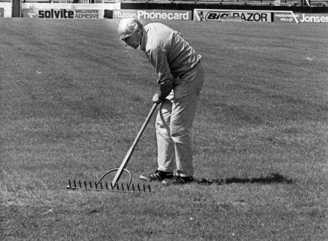 The late Les Smmons hard at work on his beloved pitch at Vicarage Road