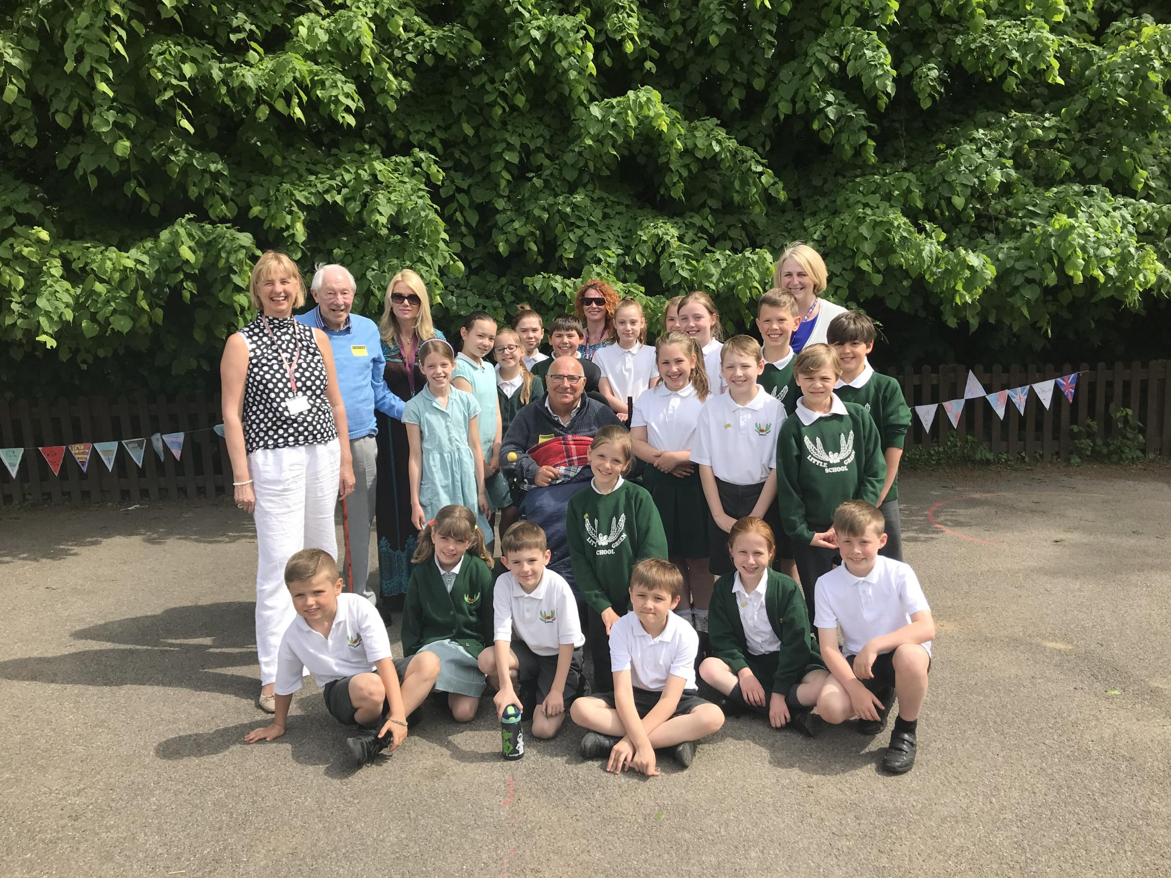Left to right: Suzanna Boddy (deputy head teacher), Albert Bullock, Jody Bryant, Malcolm Cracknell (centre), Emma Neighbour, Mrs Tearle (head teacher) and pupils from Little Green School