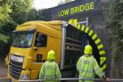 VIDEO: Lorry pulled free after nine hours stuck in a tunnel marked 'low bridge'