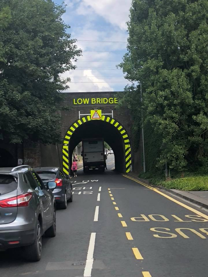 Lorry stuck in tunnel marked 'low bridge'