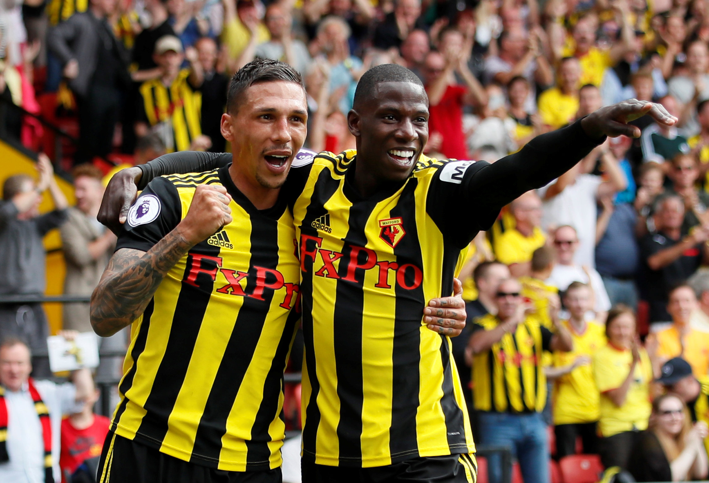 Abdoulaye Doucuoure celebrates Watford's first goal with Jose Holebas. Picture: Action Images