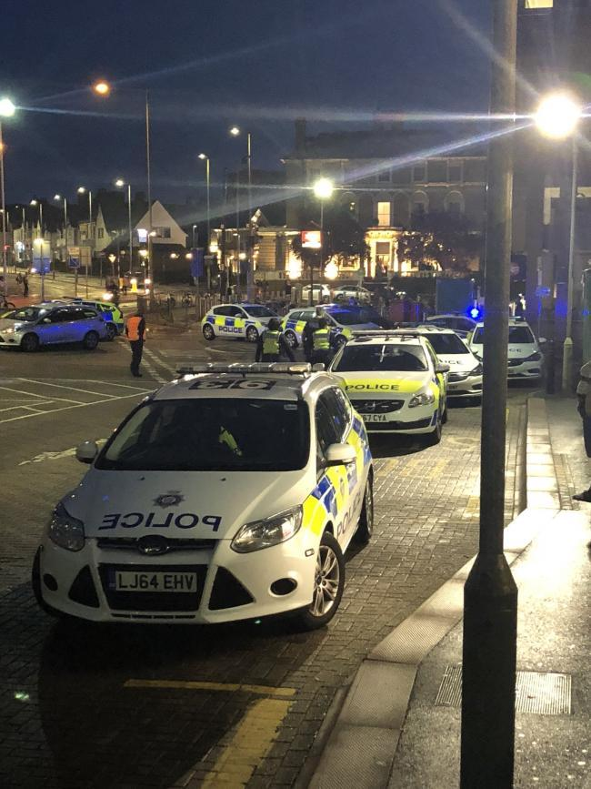 Police cars outside Watford Junction on Saturday evening Credit: Twitter/@Arez365