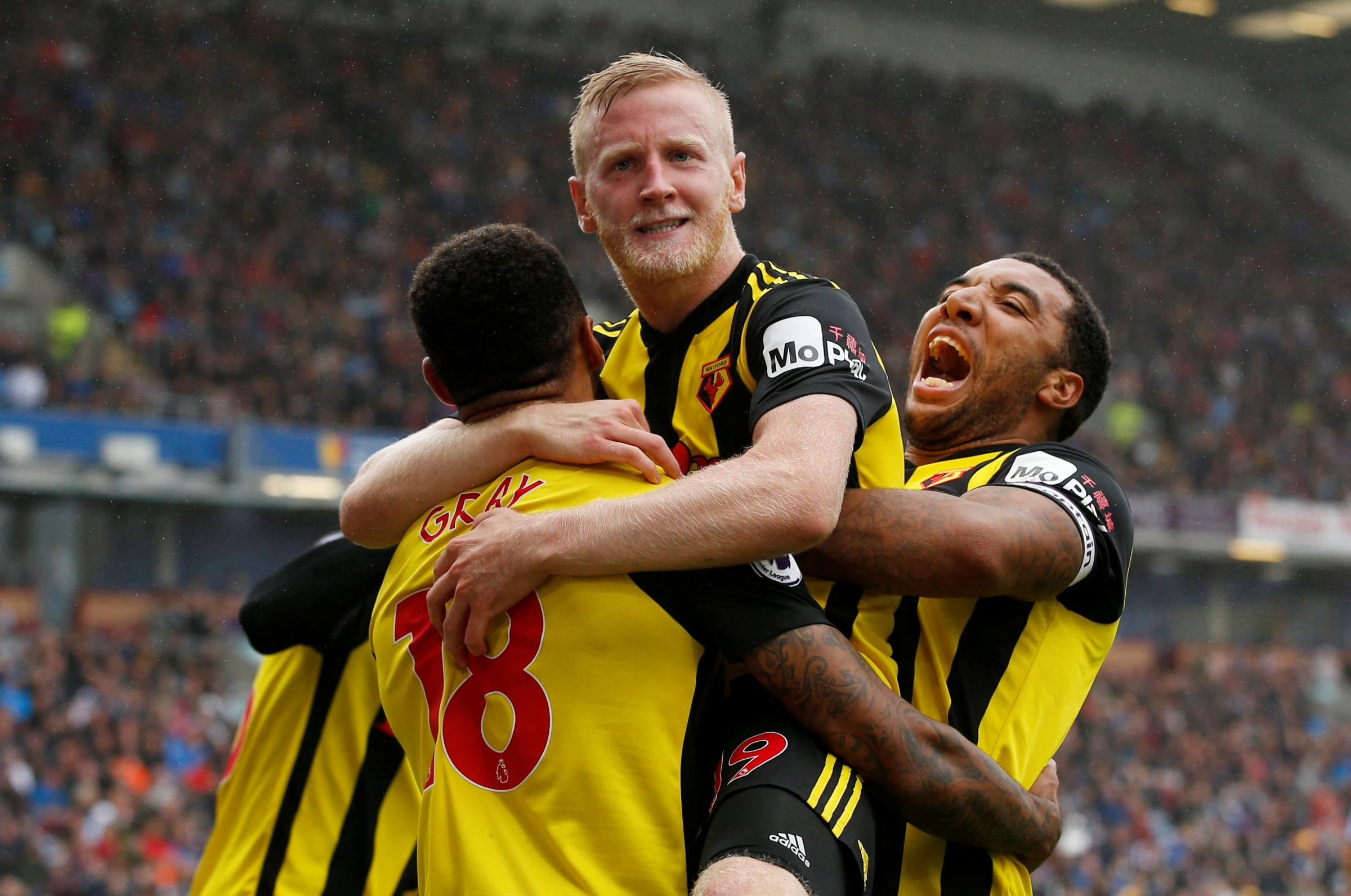 The three Hornets hit men: Will Hughes celebrates with Troy Deeney and Andre Gray. Picture: Action Images