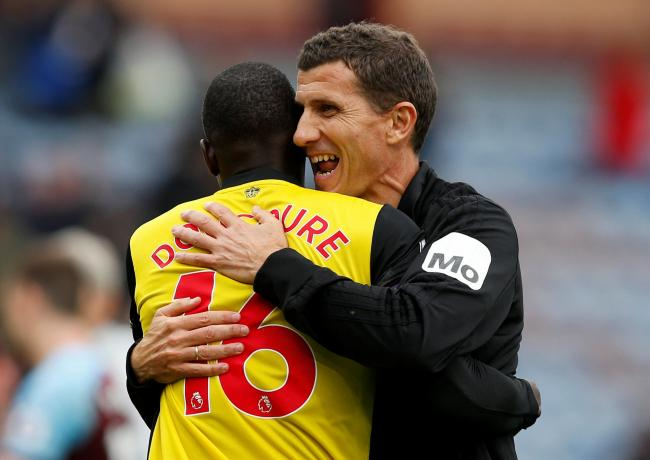 A beaming Javi Gracia embraces Abdoulaye Doucoure. Picture: Action Images