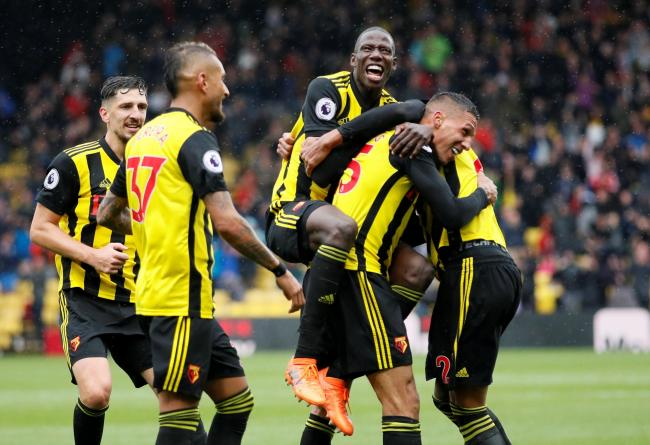 Jose Holebas is mobbed after scoring Watford's second. Picture: Action Images