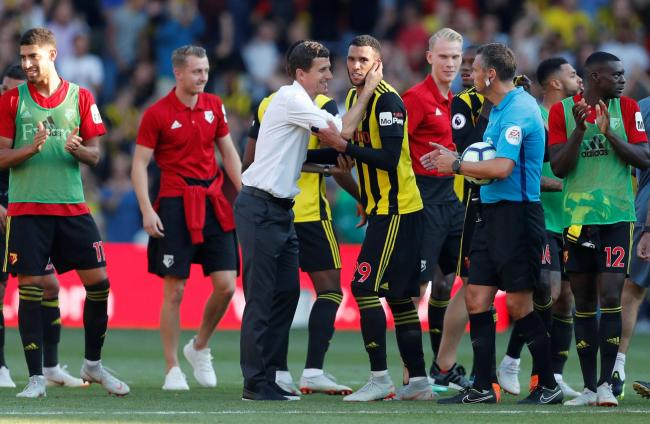Javi Gracia embraces Etienne Capoue at the final whistle. Picture: Action Images