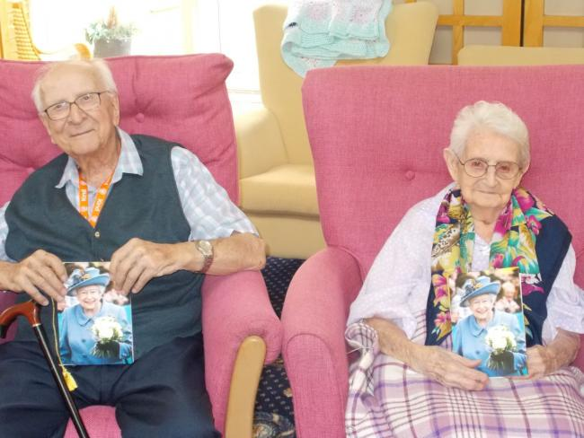 Douglas Hawes And Vera Coffin With Their 100th Birthday Cards From The Queen